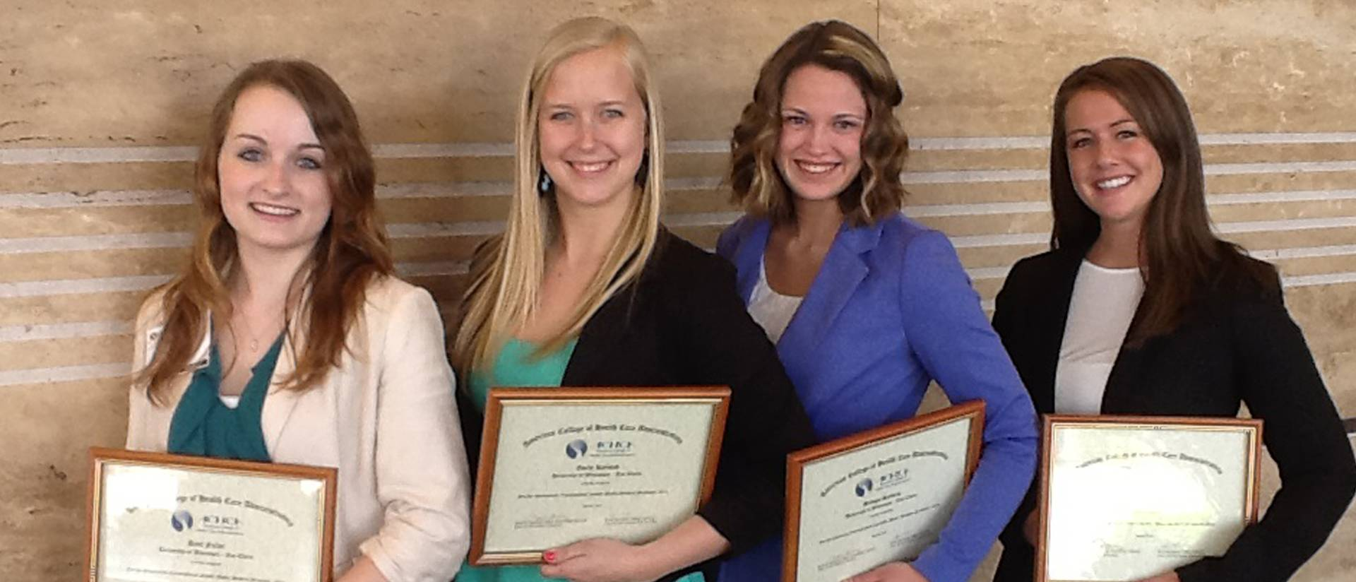 UW-Eau Claire HCAD students (from l to r) Ariel Fuller, Emily Kjelstad, Bridget Staberg, and Lori Mahan are recognized for their research posters at the 48th Annual ACHCA Convocation and Exposition and Student Poster Session in Las Vegas, NV, April 5–9, 2