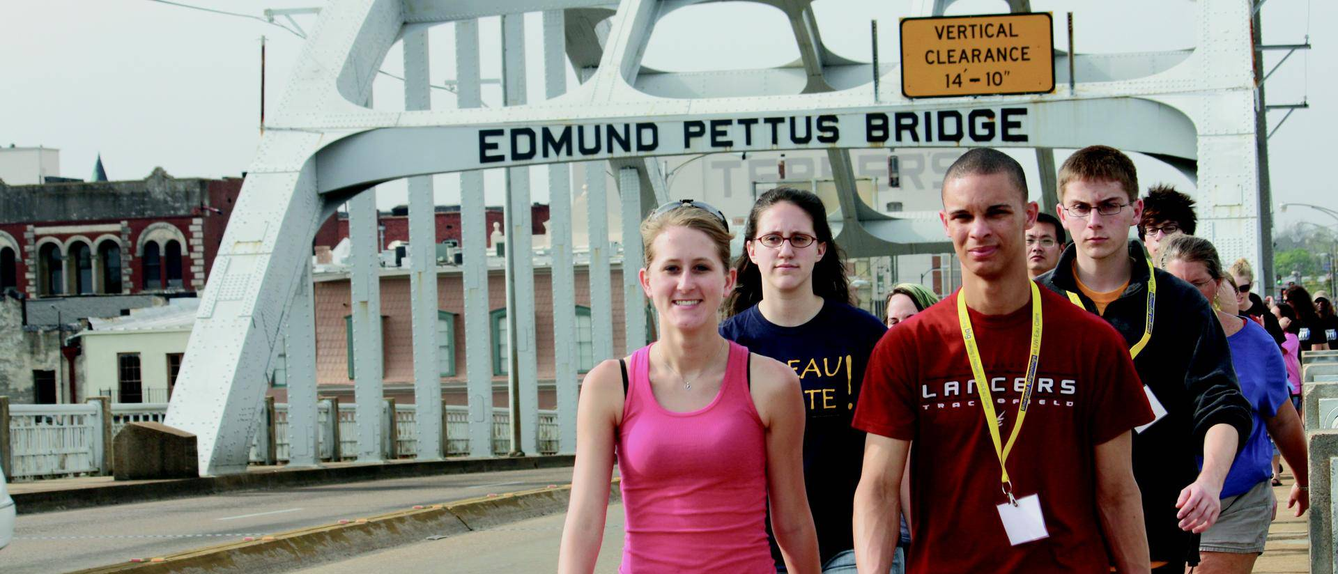 students crossing Edmund Pettus Bridge during Civil Rights Pilgrimage