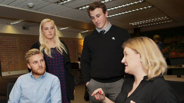 UW-Eau Claire students (from left) Adam Bergman, Brianna Noeldner and Gunner DeFlorian talk with entrepreneur Blair Foley in Volume One's WorkSpace.