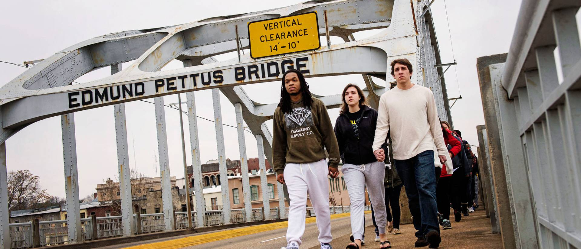 UW-Eau Claire student crossing the historic Edmund Pettus Bridge