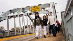 UW-Eau Claire students crossing historic Pettus Bridge in Selma, Alabama
