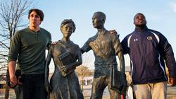 Students visiting the Little Rock Nine Memorial Statues