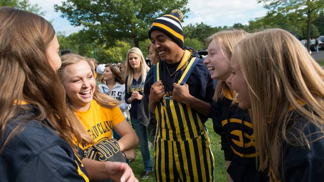 Students laughing outdoors at Blugold event.