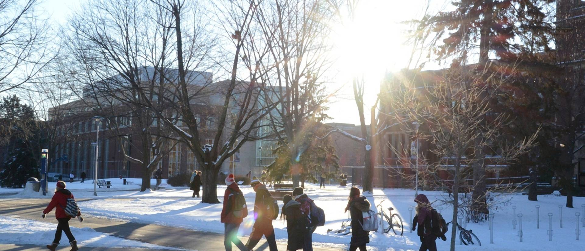 Students walking on campus in winter.