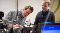 Dr. Stephen Drucker, UW-Eau Claire professor of chemistry, works on research related to photochemical reactions with student Michael McDonnell, Spring Valley.