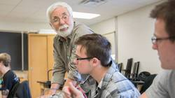 Dr. Thomas Lockhart, UW-Eau Claire professor of physics and astronomy, works in a physics lab with students Tyler Tolan, Eau Claire, and Mathew Guenther, Black River Falls, as they test for the potentials of electric fields using a digital multimeter.