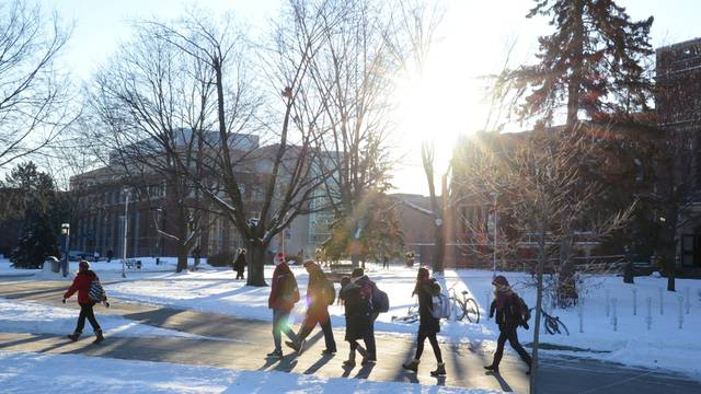 Students walking on campus in winter