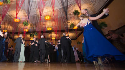 Couples swirling around the dance floor at the Viennese Ball at UW-Eau Claire
