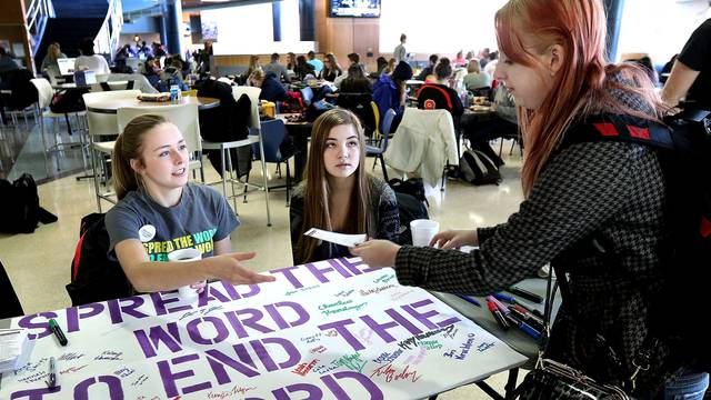 Annie Behnke and Kelsi Kruchten take pledges to end the R word at Davies Center
