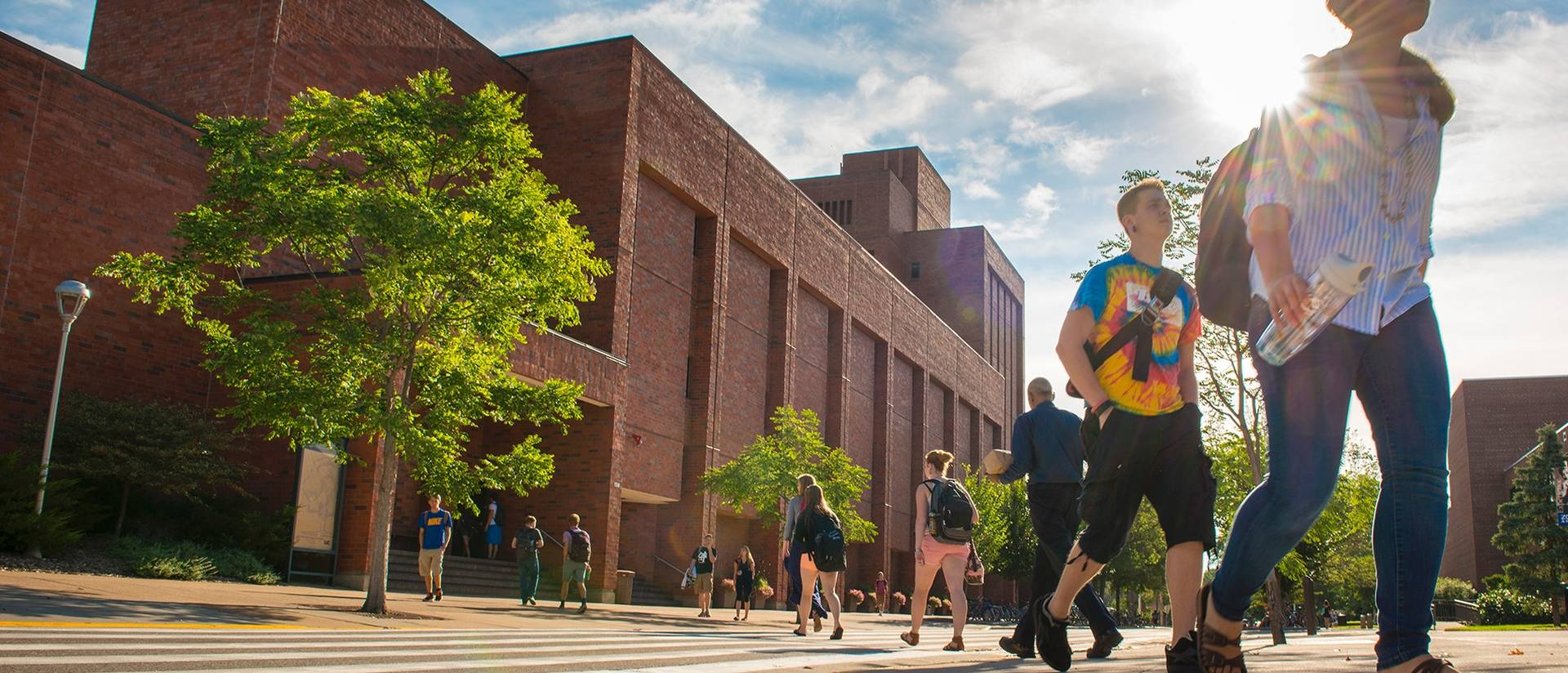 Students walking on campus on a summer day