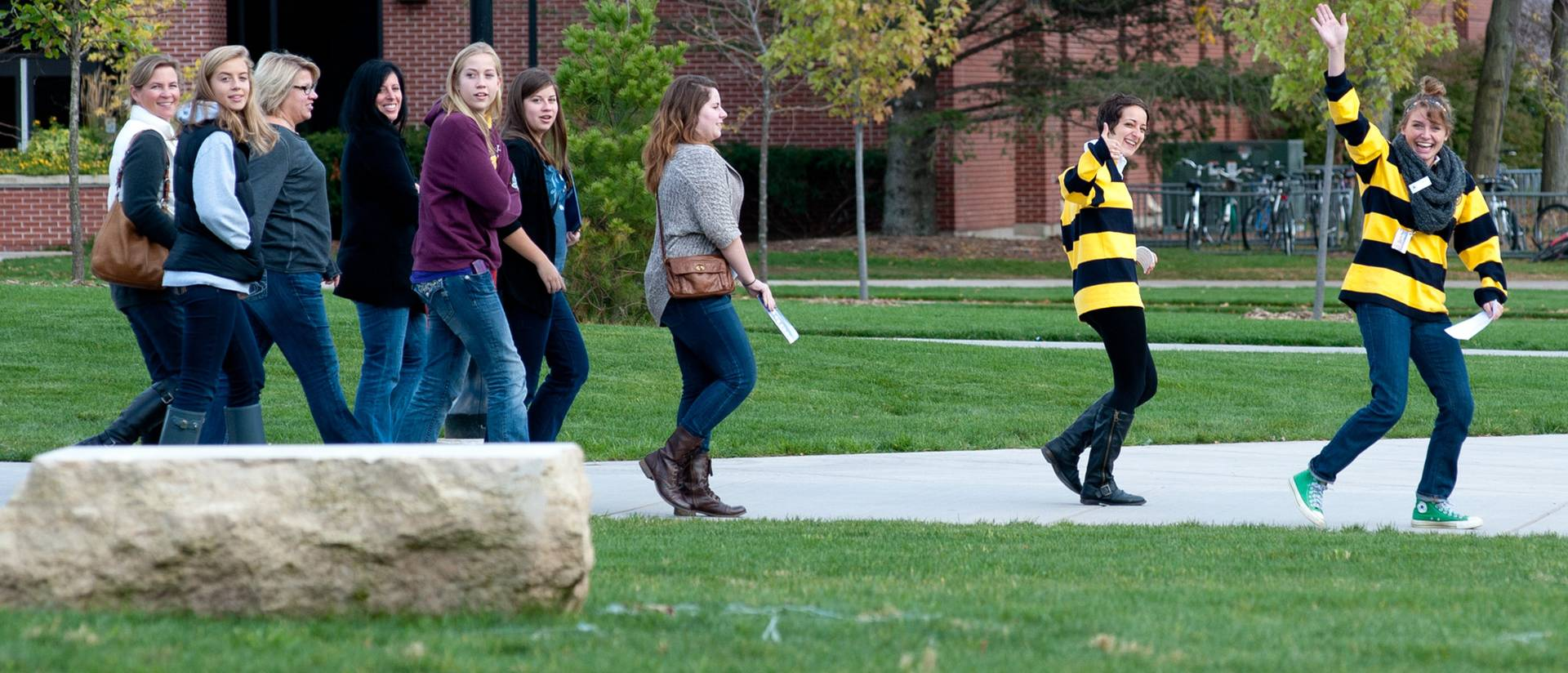 UWEC campus tour guides leading group