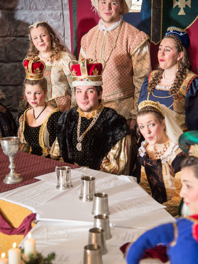 Members of the Ye Olde Madrigal Dinner sitting around the banquet table.