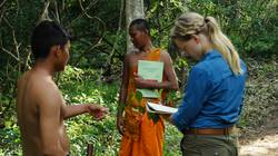 Biology students doing research alongside Buddhist monks in the Monk's Community Forest in Cambodia