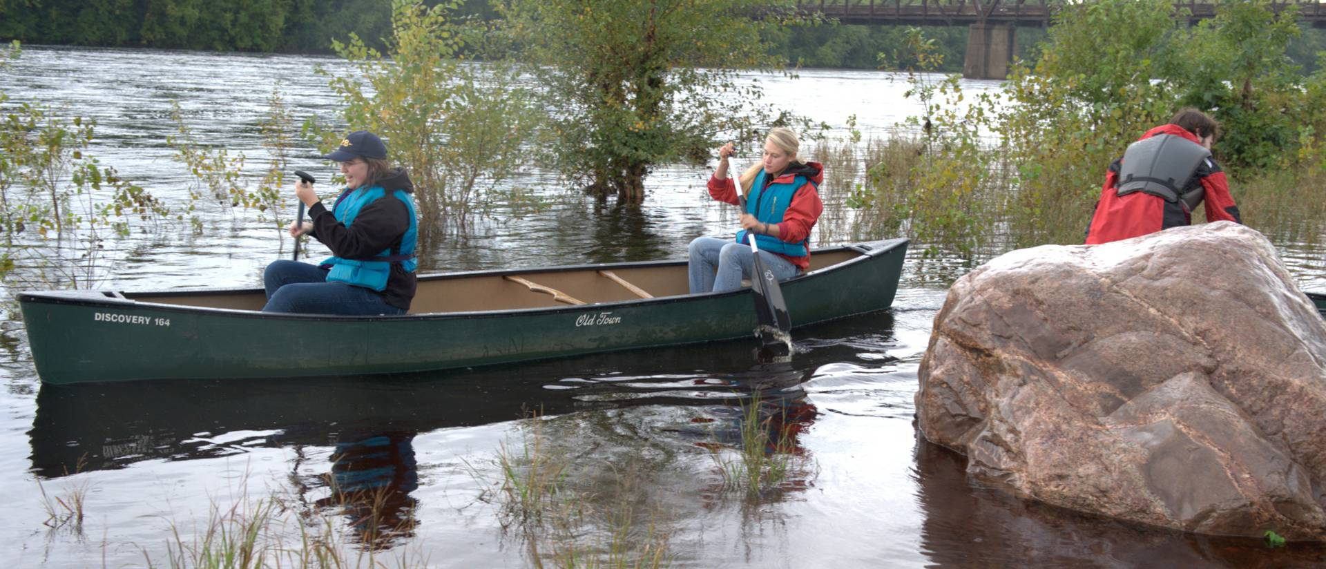 UWEC biology students canoeing on a field research trip