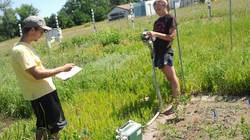 UW-Eau Claire biology students Greg and Molly measuring carbon dioxide levels at Cedar Creek Reserve