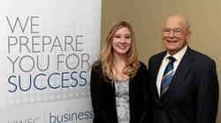 Dr. Larry Ozzello with a scholarship recipient