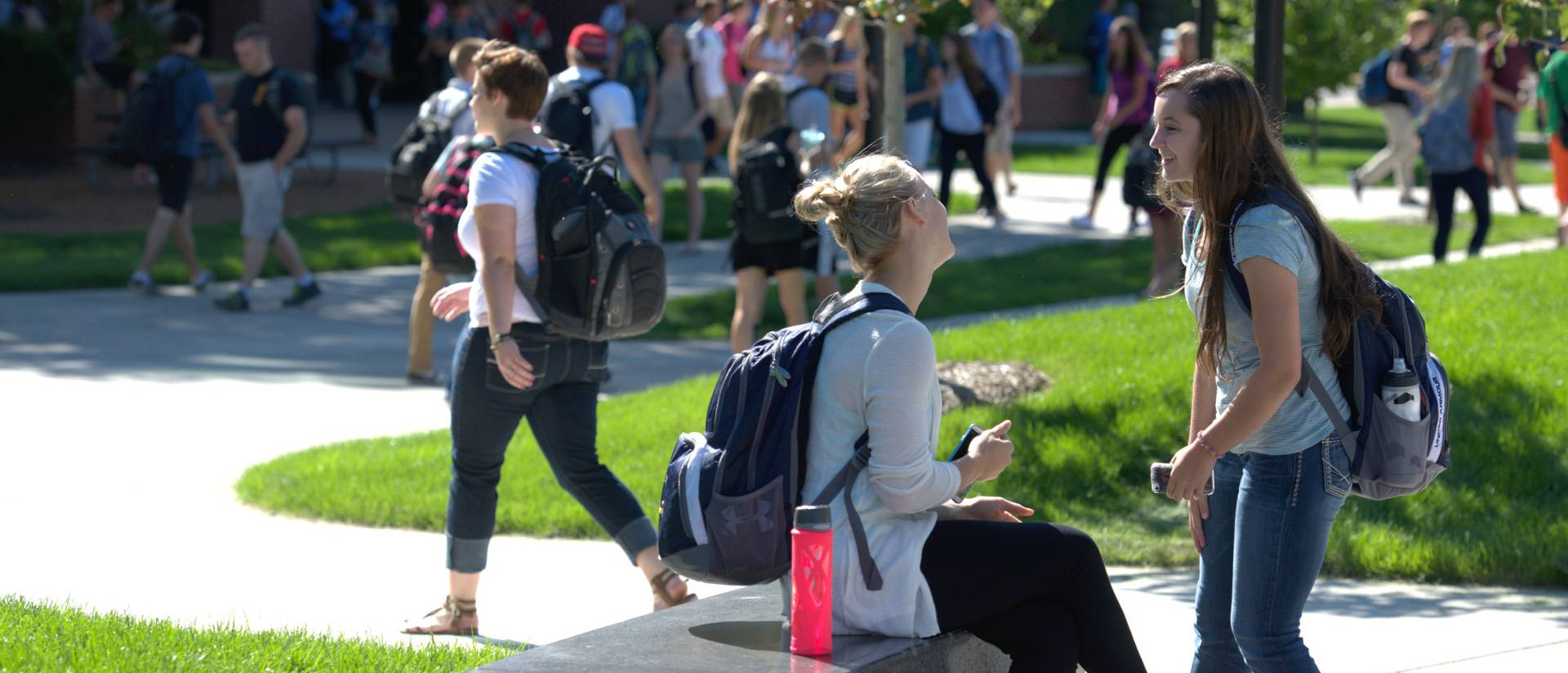 Students catch up on the first day of classes.