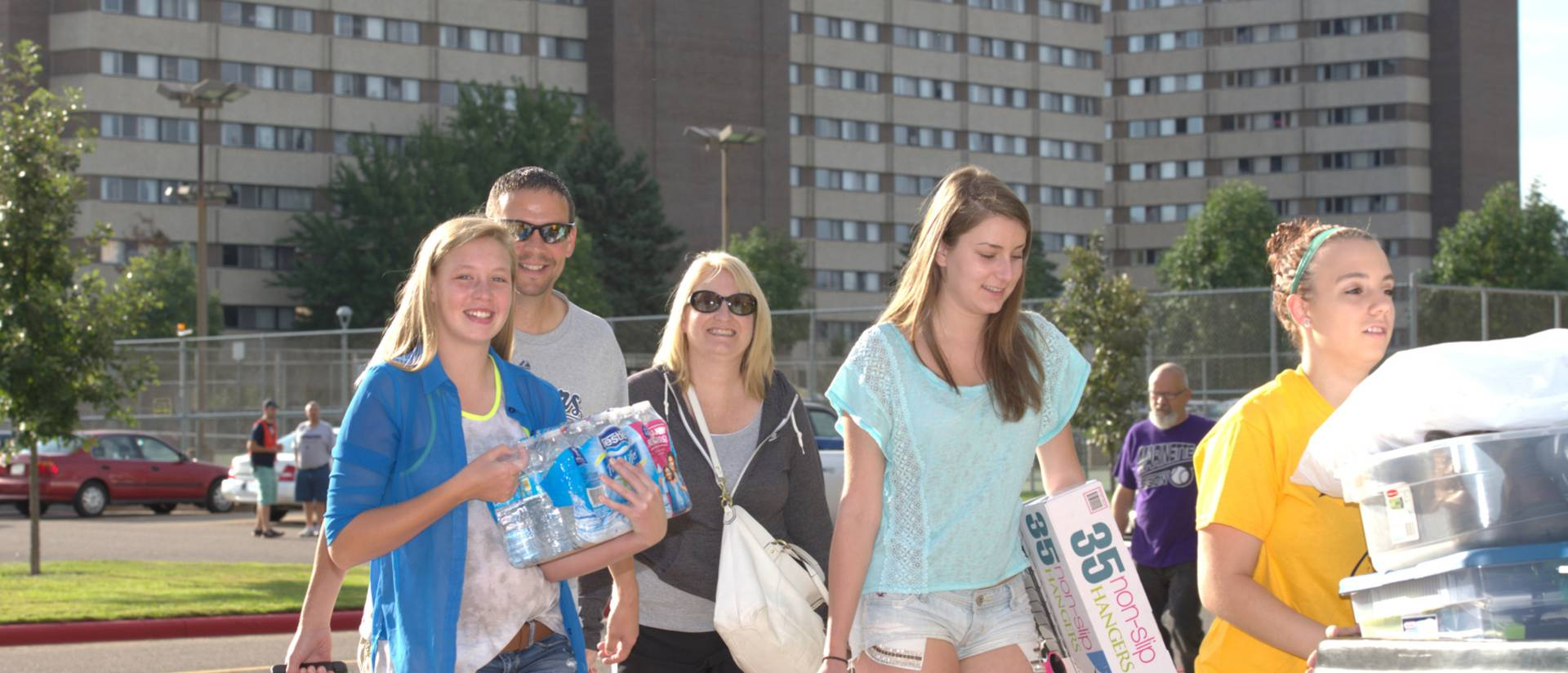 A family poses after a successful move-in to the dorms.