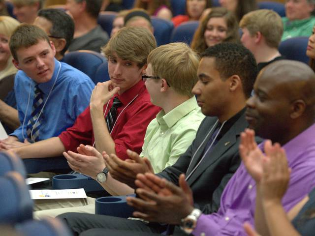 Honors students applaud each other at an awards ceremony
