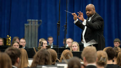UWEC conductor leads the orchestra at the annual Holiday Concert.