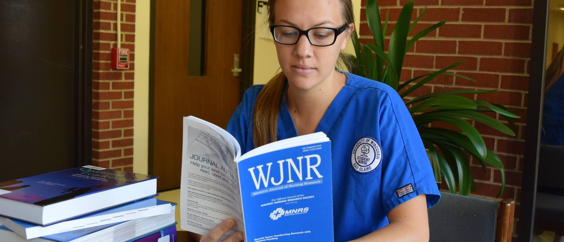 Student reading nursing journal article