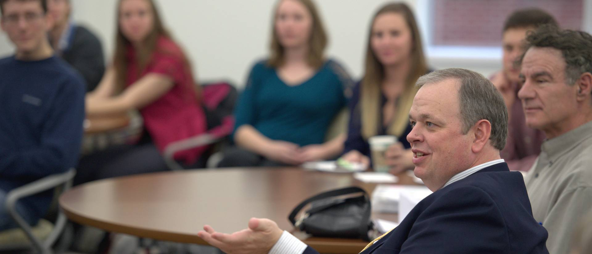 Chancellor Schmidt in discussion with students and faculty