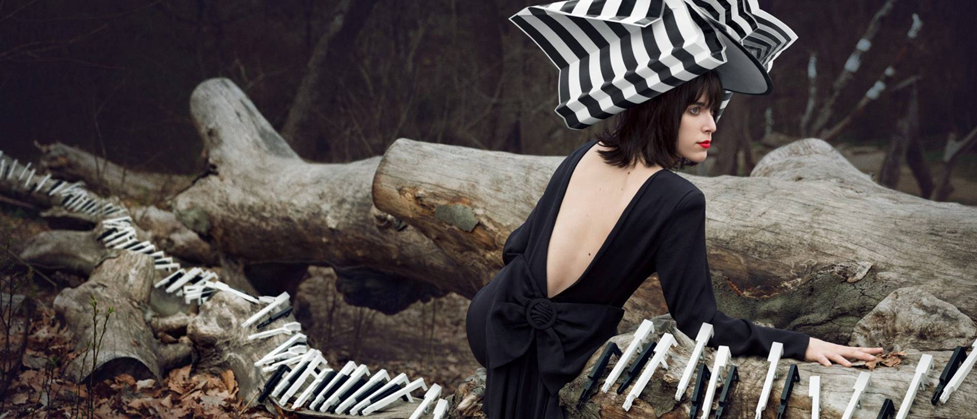 Hanna Agar's photo of woman posing with piano keys in the woods