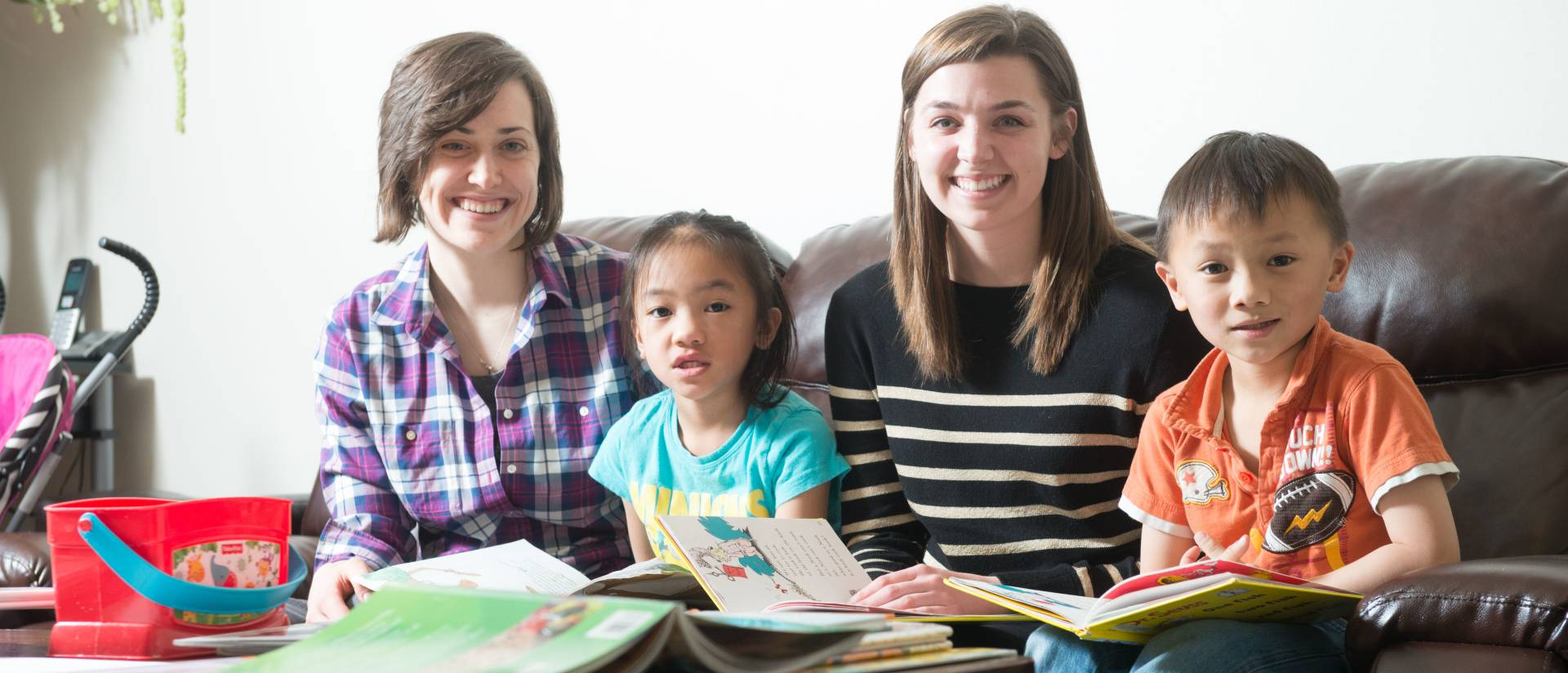 UW-Eau Claire students Jeannie LaFavor, left, and Shannon Harris, right, spend time with their reading partners.
