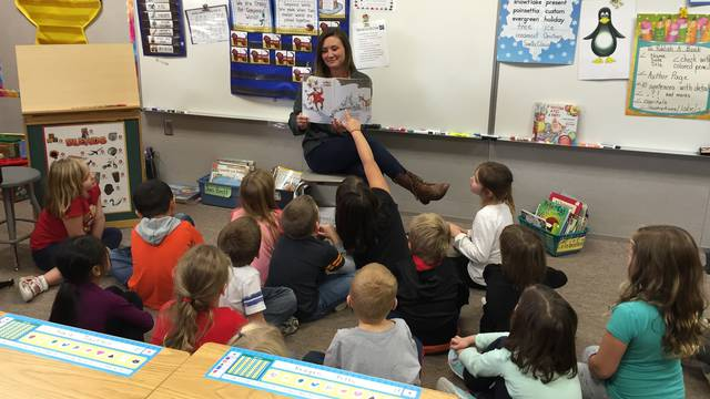 Student Rebecca Lenz reads to class during practicum experience