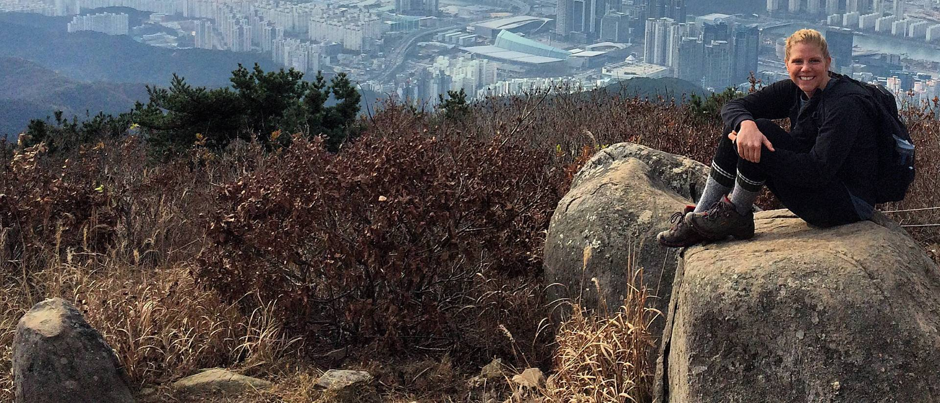 Elise Rooney sits on Jansang Mountain in her backyard in Busan, South Korea.