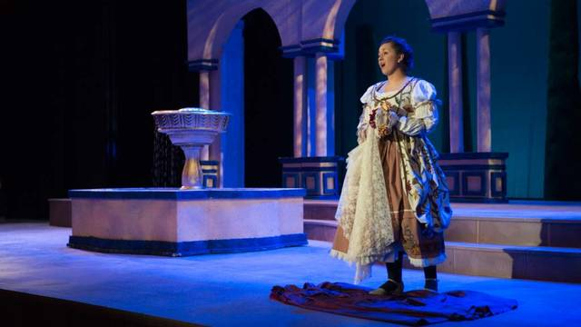 "Gina Cruciani sings in the role of Susanna during a spring 2015 performance of the opera ""The Marriage of Figaro."""