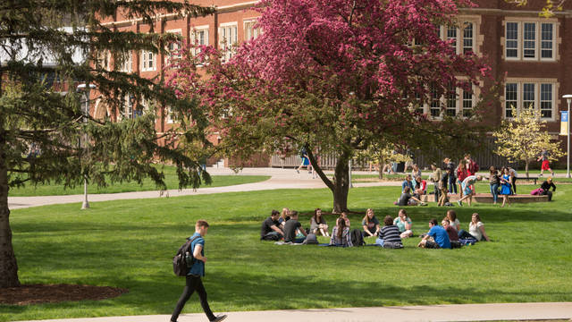 spring scene of students outside Schofield Hall