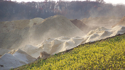 Sand blowing off of Silica Sand pile in Bloomer, WI