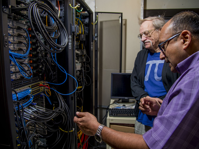Dr. Bhattacharyay working with another professor on the supercomputer.