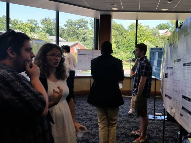 Students presenting research at a conference
