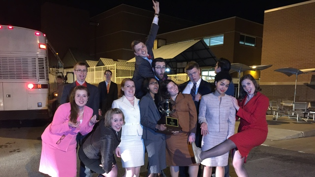Forensics team with trophy
