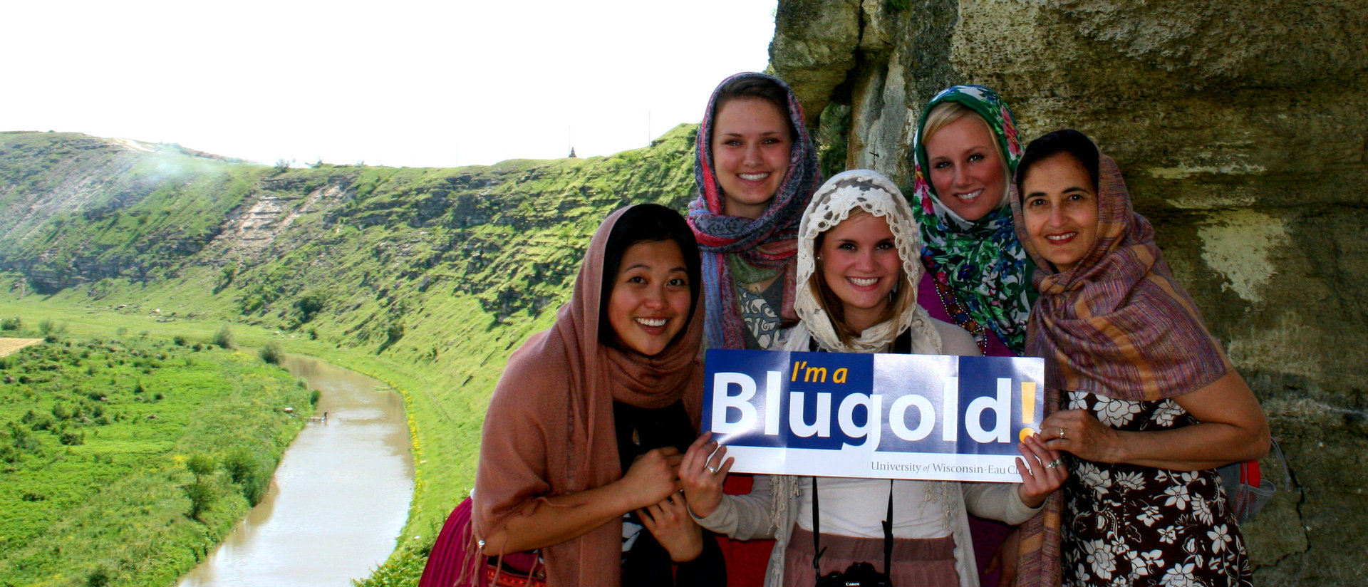 "Students holding up ""I'm a blugold"" sign in Moldova."