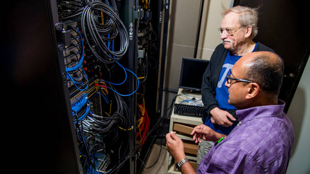Dr. Bhattacharyay and Dr. King working on the supercomputer.