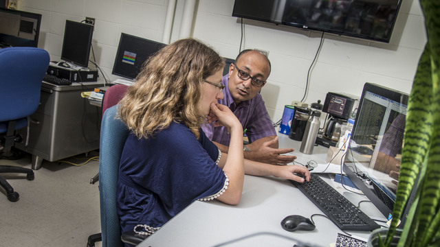 Dr. Bhattacharyay working with a student.