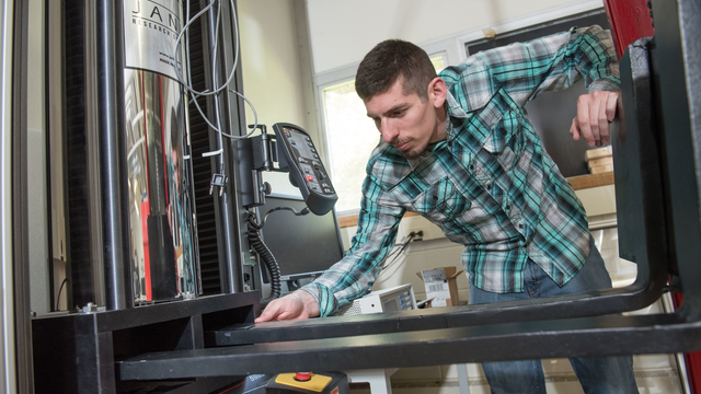 Student sets up equipment in lab