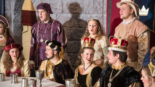 Students performing the Ye Olde Madrigal Dinner for the community