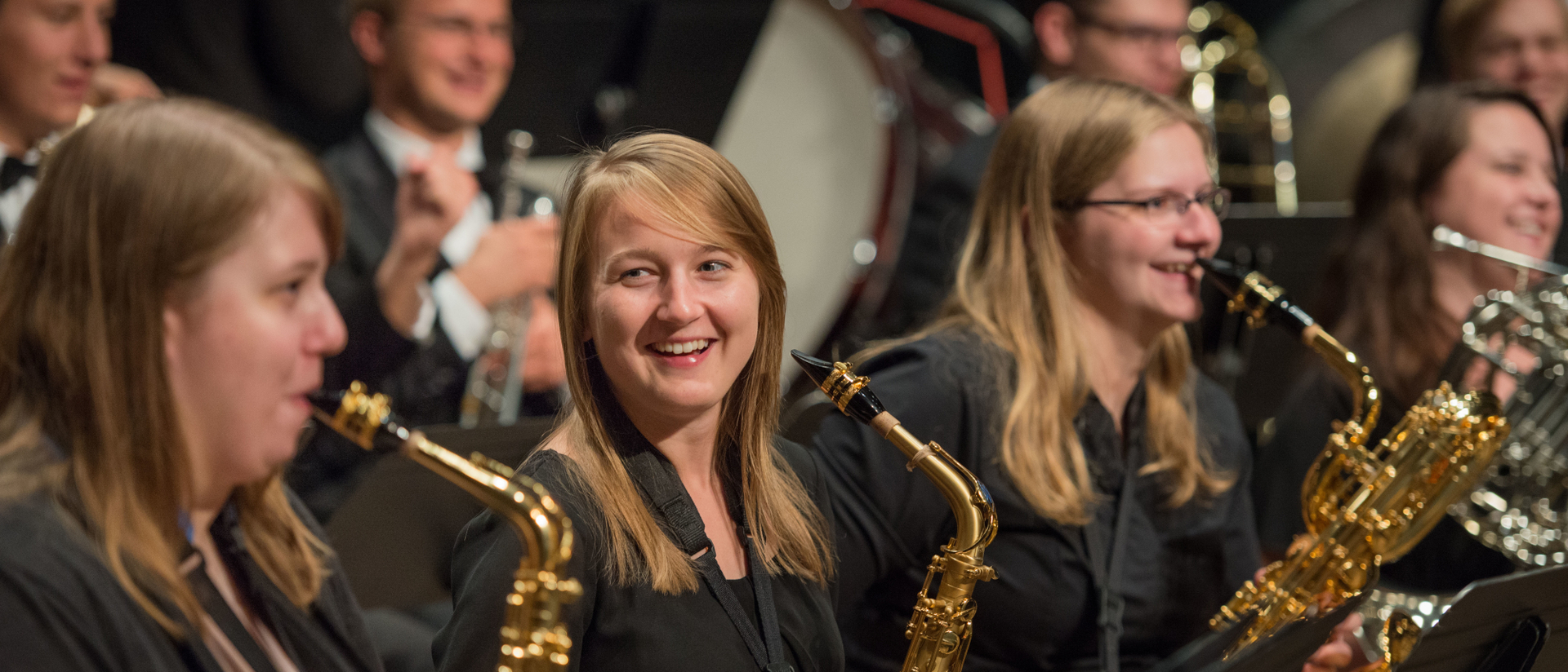 Saxophone players smiling during song break