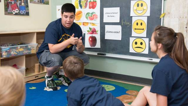 Blugolds teaching children Spanish