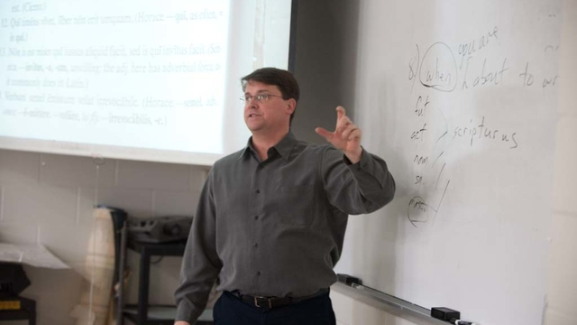 UWEC Languages professor Matt Waters in class