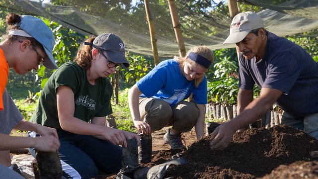 Students assisting with farming