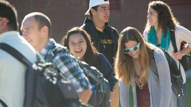 Students laughing while walking