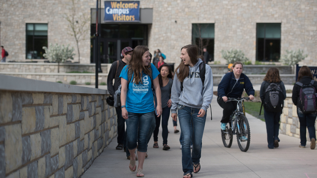 Students walking through campus mall