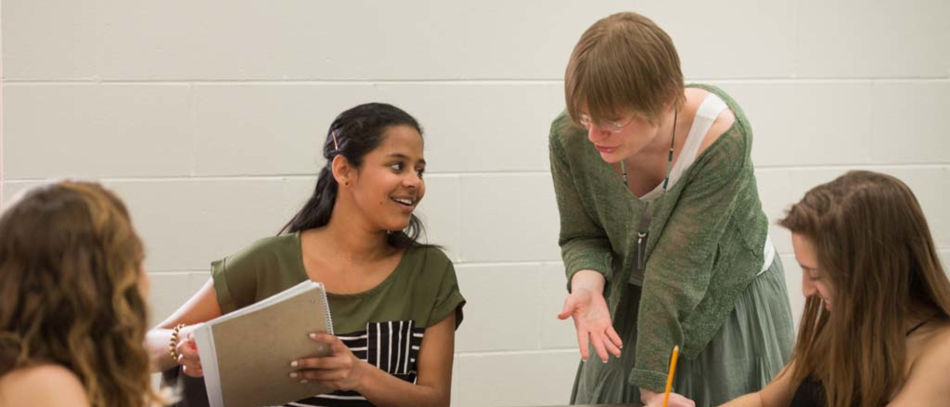 A professor and student work together.