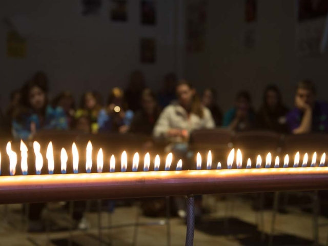 Students watch a fire experiment on Math