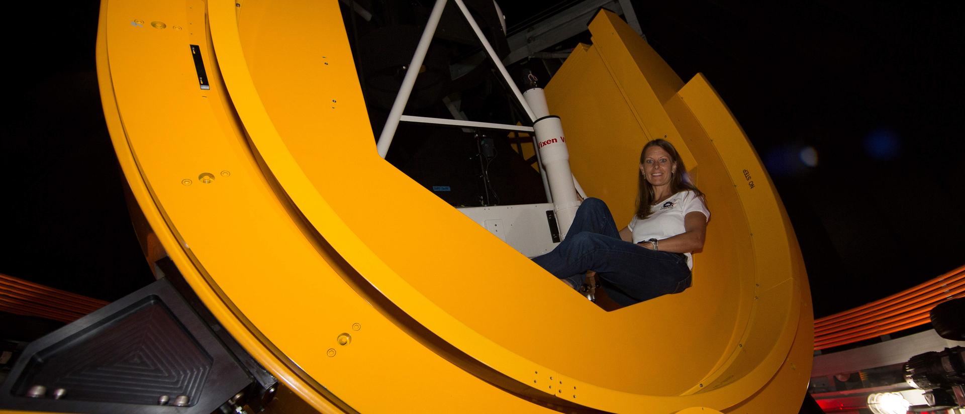 Alumna Susan Lederer in telescope she built for NASA